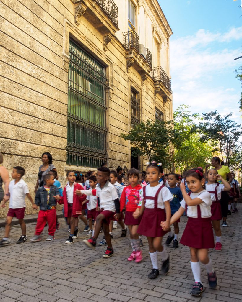 Quotidian Vista of La Habana Vieja: Primary school students marching through the streets BY RUDY GIRON
