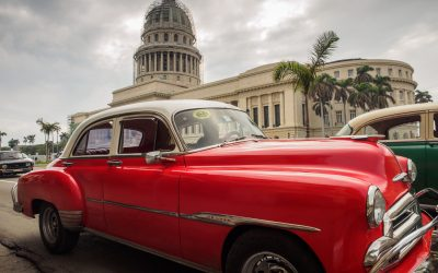 #TravelPhotographyWorkshop — Red classic car in front of the Capitolio in Havana, Cuba